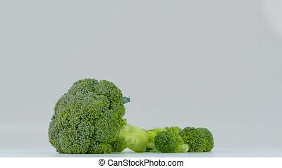 whole and sliced inflorescence Broccoli on white background...