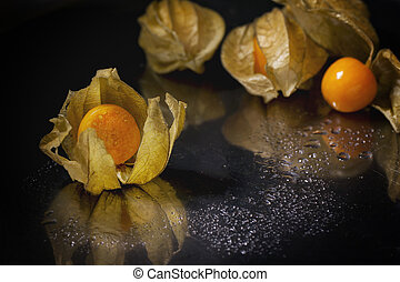 Whole and sliced physalis