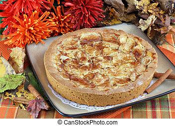 Whole apple kuchen cake in fall setting. - One whole apple ...