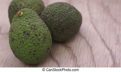 Whole Avocados on Wood Dolly - Close up dolly shot of fresh,...