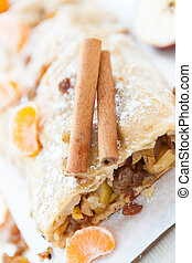 whole cake with apples and cinnamon in a cut