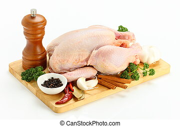 whole chicken on a cutting board - studio shot of whole...