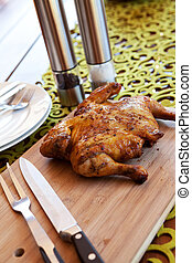 Whole chicken with cutlery and spices