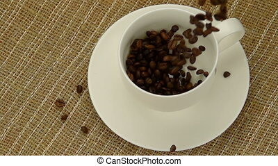 Whole Coffee Beans  Falling into the Cup