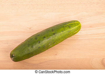 Whole Cucumber on Wood Table