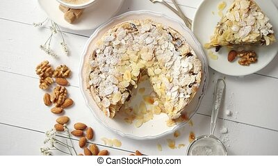 Whole delicious apple cake with almonds served on wooden ...