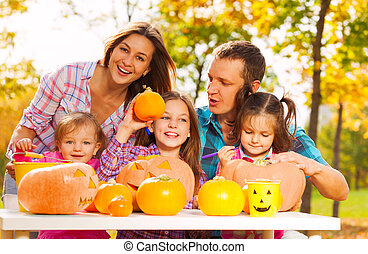 Whole family get ready for Halloween in the garden