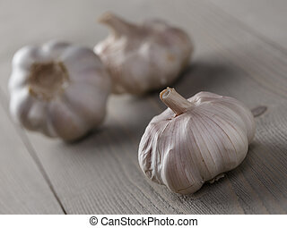 whole garlic on wood table, rustic style