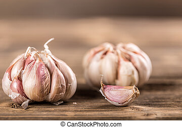 Whole garlic on wooden table