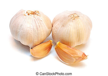 Whole garlic with slices isolated on white background