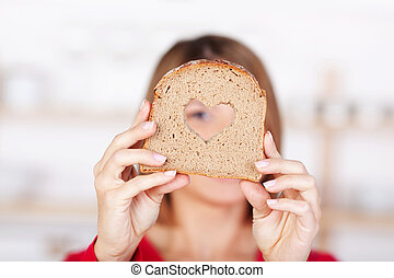 Slice of whole grain bread with a heart