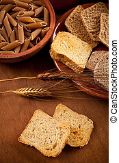 Whole grain carbohydrates on wooden table