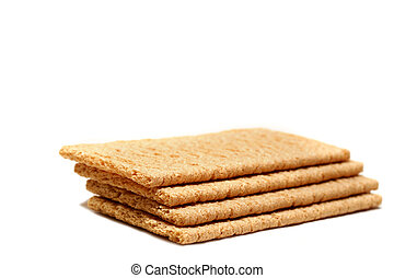 Whole Grain Crackers - Crispy whole grain crackers on white...