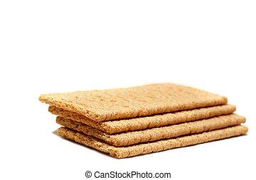 Crispy whole grain crackers on white background