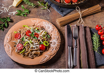 Whole grain pasta with cheese parmesan and tomatos