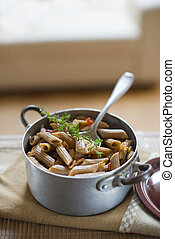 Whole grain pasta with tomato sauce close up shoot