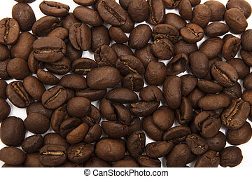 Whole grains of coffee on a white background