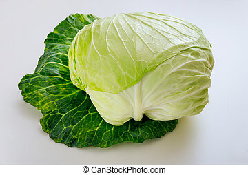 Whole green cabbage isolated on a white background.