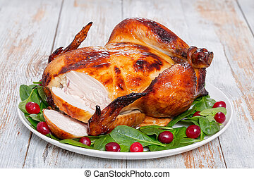 whole grilled chicken cut into slices, close-up