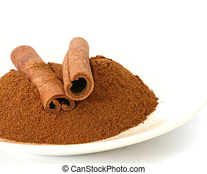 Whole ground cinnamon and sticks on plate white background