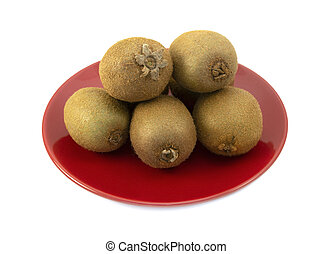 Whole kiwifruits with hairy skins piled on a red plate
