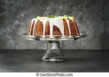 Whole Lemon Bundt Cake in Center of Dark Background