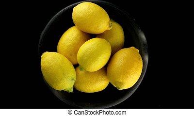 Whole lemons on black - Whole lemons rotating on black...