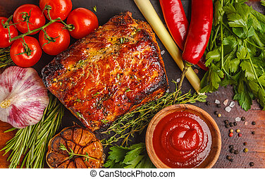 Whole piece of roast pork with thyme, rosemary, garlic and tomato sauce on wooden board, white background, macro