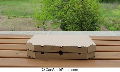Whole pizza in a box