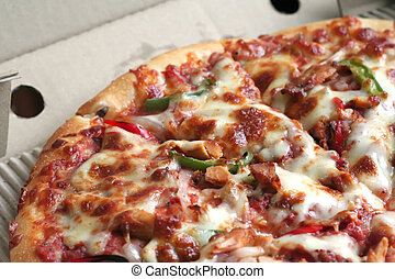 Whole pizza - Sliced whole cheese and meat pizza in the box