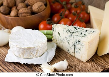 Whole portion of camembert with other kinds of cheese
