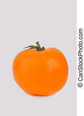 Whole ripe orange tomato isolated on white.