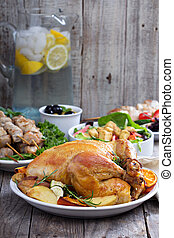 Whole roasted chicken on dinner table
