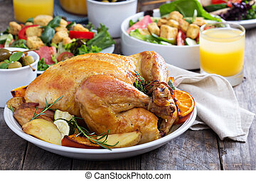 Whole roasted chicken on dinner table - Whole roasted...