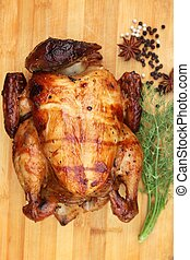 Whole roasted chicken with fresh vegetables