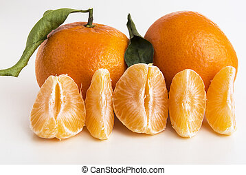 Whole tangerine or clementine and peeled segments