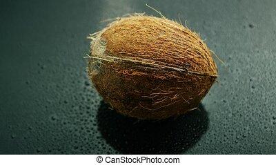 Whole unpeeled coconut - Closeup shot of whole unpeeled...