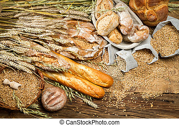 Whole wheat bread on old wooden table