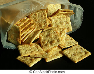 wheat crackers - whole wheat crackers tumbling out of the...