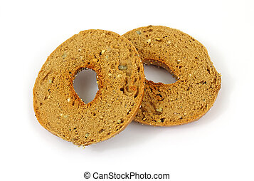 A single whole wheat grain bagel that has been cut in half and toasted on a white background.