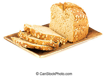Wholegrain bread bun with oat on wooden tray isolated on white background.