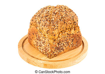 Wholegrain bread bun with seeds on wooden board isolated on white background.