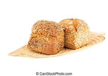 Wholegrain bread buns with seeds and oat on wooden tray isolated on white background.