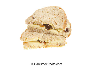Wholemeal bread cheese and pickle sandwich isolated on white