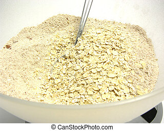 Wholemeal, cocoa and oat flakes on digital scales
