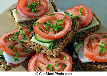 Wholemeal rye bread sandwich with tomato, cucumber, radish...