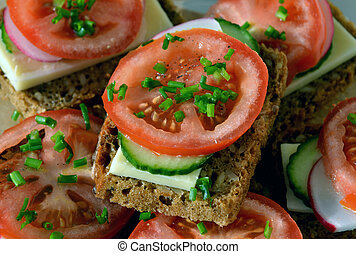 Wholemeal rye bread sandwich with tomato, cucumber, radish ...