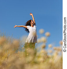 Wholesome brunette woman outdoors in a field of weeds