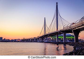 WHSD bridge in St. Petersburg in the evening at sunset. High-speed bypass toll road. Petersburg bridges. New modern bridge. Modern construction technologies.