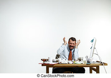 Young man suffering from the noise in the office